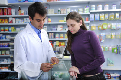female customer consults male pharmacist