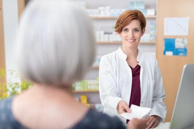female pharmacist with a customer